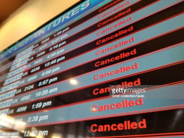 Flight departures board showing all flights canceled during a snow event at Newark International Airport, Newark, New Jersey, March 21, 2018.