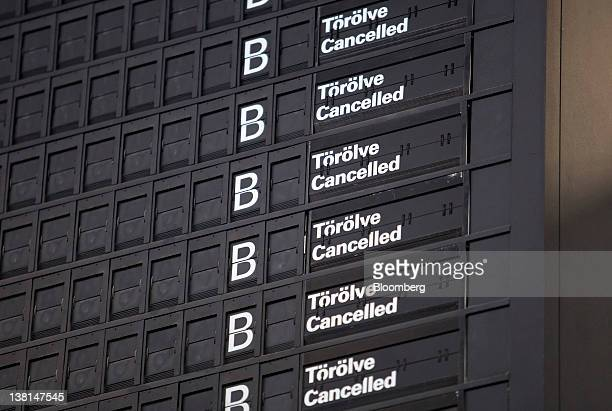 A flight departures board shows all Malev Zrt airline flights cancelled at Ferenc Liszt international airport after the government forced the...