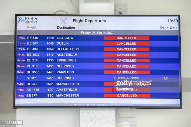 A flight departures schedule list shows cancelled Flybe Group Plc flights in the departures terminal at Exeter Airport in Exeter UK on Friday March 6...
