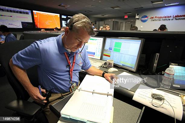 Flight director Keith Comeaux works inside the Spaceflight Operations Facility prior to the landing of NASA's Mars Science Laboratory Curiosity rover...