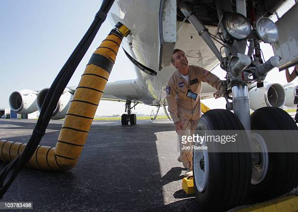 NASA flight Engineer Bill Fleming conducts a flight check around the DC8 aircraft as they prepare it to fly into Hurricane Earl on another mission...