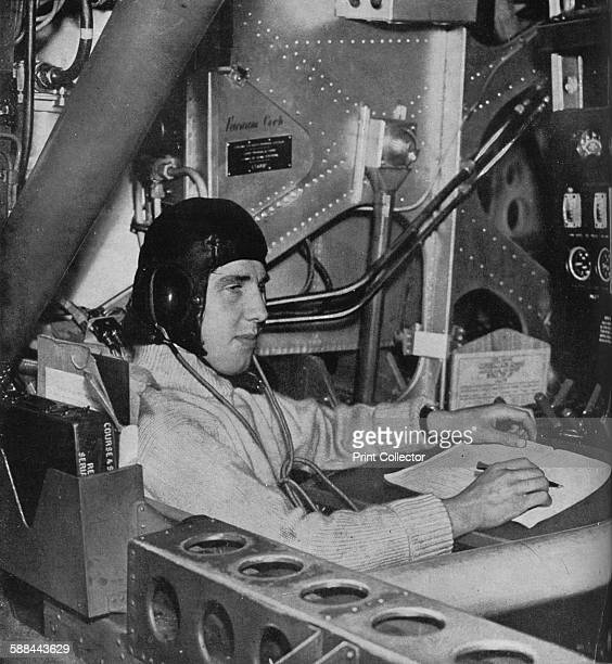 RAF flight engineer on board an aircraft circa 1940 The flight engineer watching his instrument board which tells him how the engines are behaving...