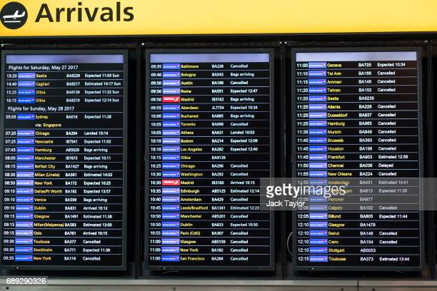 Flight information boards display a number of cancelled British Airways flights at Heathrow Airport Terminal 5 on May 28 2017 in London England...