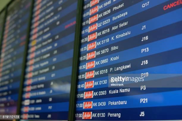 flight information - kuala lumpur international airport stock photos and pictures