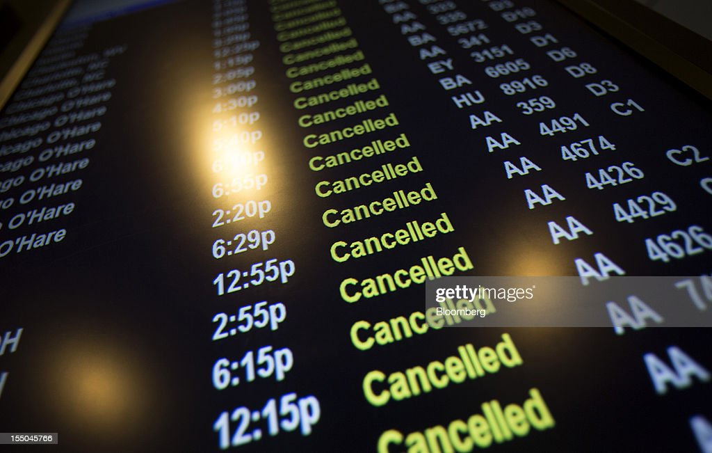 A flight information terminal displays cancelled flights at LaGuardia Airport in New York, U.S., on Monday, Oct. 29, 2012. Hurricane Sandy disrupted air travel across the U.S., grounding more than 9,500 flights today and tomorrow as the storm barreled toward the northeast and forced the region's major airports to suspend operations. Photographer: Scott Eells/Bloomberg via Getty Images