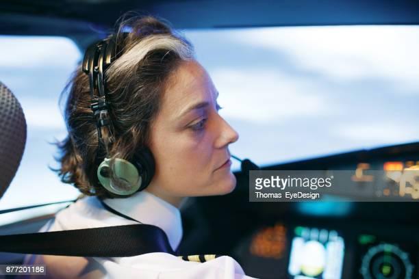 Flight Instructor Operating Aircraft Simulator