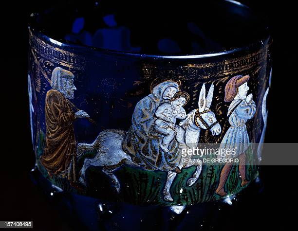 Flight into Egypt detail from a Venetian goblet decorated with blue glass and polychrome enamel 14601470 Italy 15th century Bologna Museo Civico...