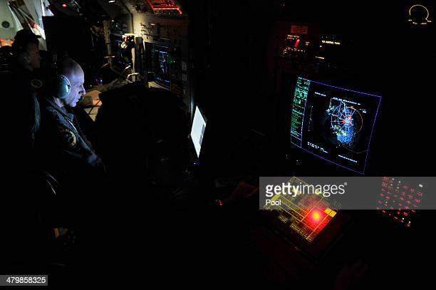 Flight Leiutenant Neville Dawson on board a Royal Australian Airforce AP-3C Orion from Pearce Airforce Base during a search mission for possible...