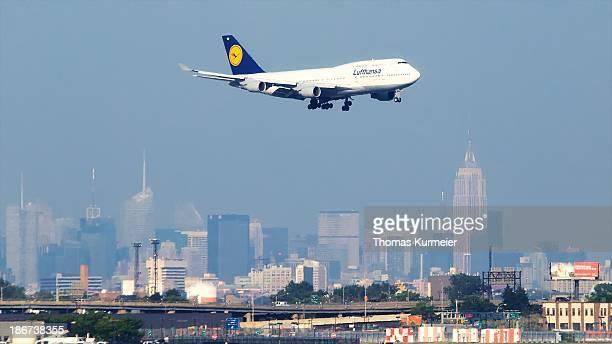 CONTENT] Flight LH 402 FRA EWR landing at Newark Liberty International Airport Manhattans skyline in the background