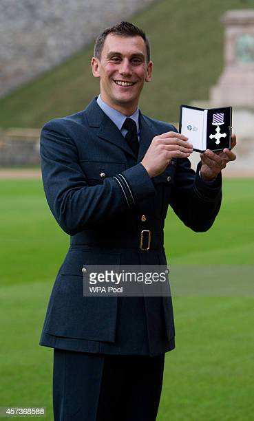 Flight Lieutenant Charles Lockyear of the Royal Air Force poses after being awarded a Distinguished Flying Cross by Queen Elizabeth II following an...