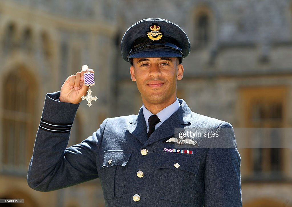 Flight Lieutenant Christopher Gordon after he received the Distinguished Flying Cross from Queen Elizabeth II during an Investiture ceremony at Windsor Castle on July 19, 2013 in Windsor, England.