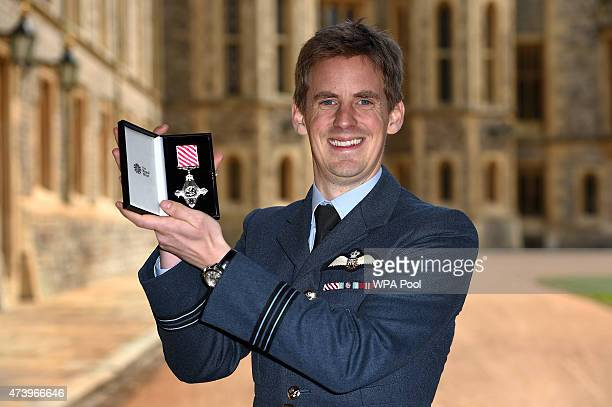 Flight Lieutenant Edward Berwick of the Royal Air Force with his Air Force Cross for great courage in the air at an investiture ceremony at Windsor...