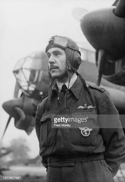 Flight Lieutenant Ernest Richards Lewendon , Commanding Officer of No1426 Flight RAF and known as the Rafwaffe stands in front of a captured Nazi...