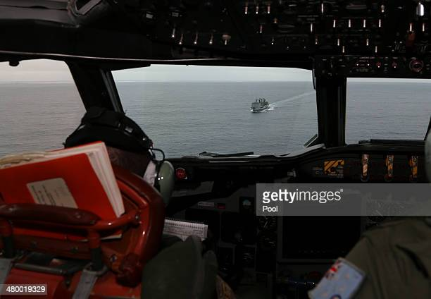 Flight Lieutenant Jason Nichols on board a Royal Australian Air Force AP3C Orion looks ahead towards HMAS Success as they search for missing...