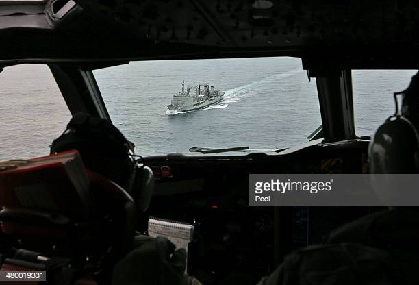 Flight Lieutenant Jason Nichols on board a Royal Australian Air Force AP-3C Orion, looks ahead towards HMAS Success as they search for missing...