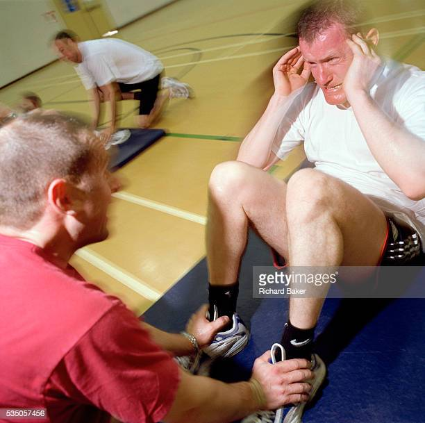 RAF Flight Lieutenant Jez Griggs exerts his last tough repetition of situps to reach his target during his annual basic fitness test Griggs is a...