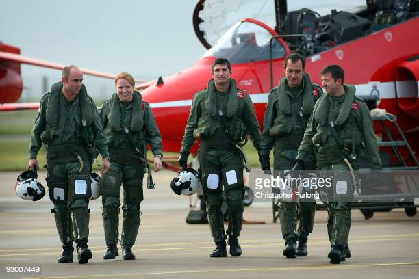 Flight Lieutenant Kirsty Moore , the first ever female Red Arrows pilot returns from flying with her team mates Ben Plank, Zane Sennett, Ben Murphy...