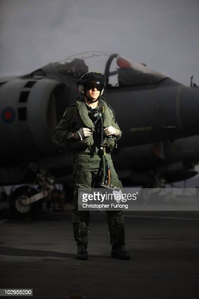 Flight Lieutenant Nick Lane of 1 Joint Force Harrier Squadron stands by his Harrier jet on the flight deck of HMS Ark Royal during Exercise Auriga on...
