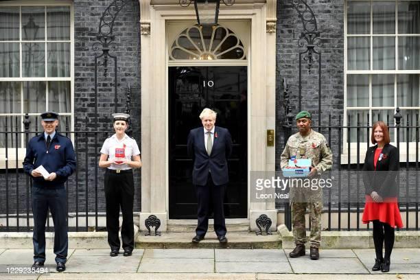 Flight Lieutenant Ollie Smith of the RAF, Able Seaman Laura Chisholm of the Royal Navy, British Prime Minister Boris Johnson, Staff Sergeant Ilaitia...