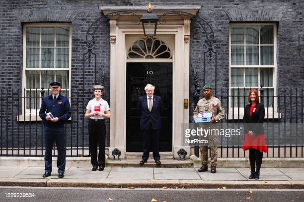 Flight Lieutenant Ollie Smith of the Royal Air Force , Able Seaman Laura Chisholm of the Royal Navy , British Prime Minister Boris Johnson , Staff...