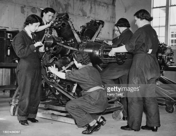 Flight mechanics of the Women's Auxiliary Air Force undergo maintenance work on an aircraft radial engine at Technical Training Command as part of...