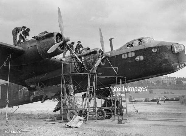 Flight mechanics of the Women's Auxiliary Air Force undergo maintenance work on the Bristol Hercules radial engines of a Technical Training Command...