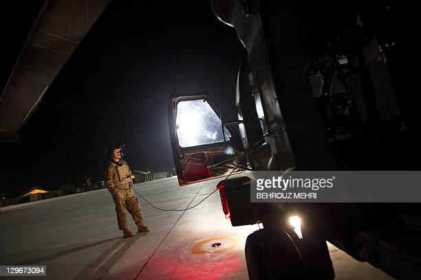 US Flight Medic Officer staff sergeant Donald Marchetti from 159th Brigade Task Force Thunder waits at Kandahar Air Field while the pilots reads the...