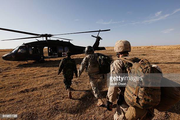 Flight medic Sgt Aaron Burrows of Amarillo TX with C Company Dustoff 3rd Battalion of the 82nd Combat Aviation Brigade 82nd Airborne Division leads a...