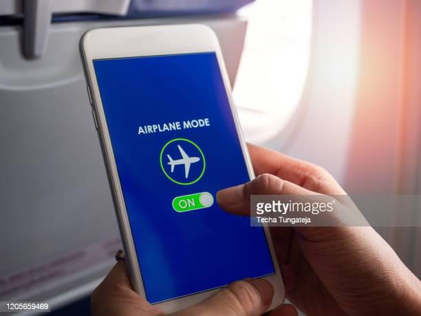 flight mode concept closeup finger sliding