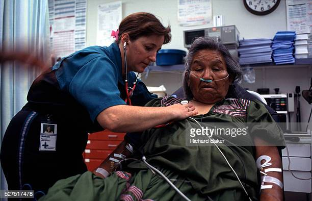 A flight nurse examines a lady from the Native American Reserve at San Carlos Arizona from where she is to be taken from the rural Arizona airstrip...