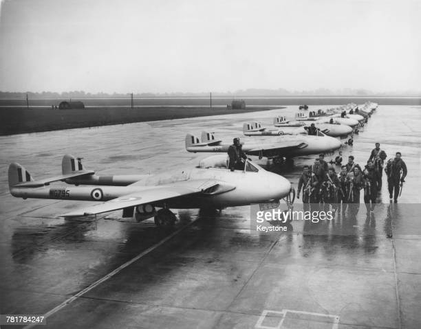 A flight of de Havilland Vampire jet fighters of No1 Squadron Royal Air Force are formed up as pilot pupils from No5 Flying Training School prepare...
