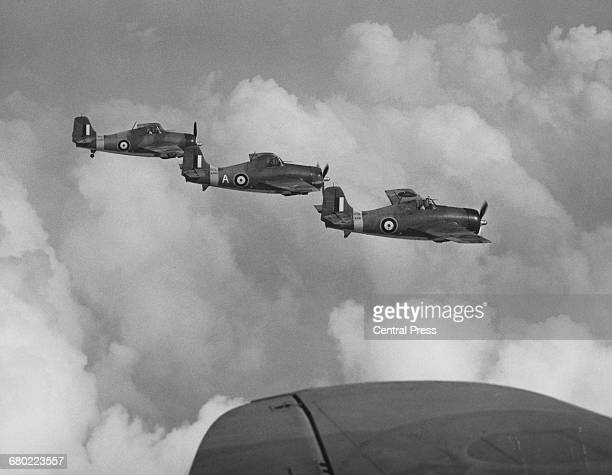 Flight of Grumman F4F Martlet carrier-based fighter aircraft of the Fleet Air Arm during patrols in the Atlantic on 29 September 1941 off the Bay of...