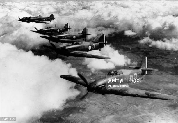 A flight of Hawker Hurricane MkI monoplane fighters of No 73 Squadron Royal Air Force join up into a close echelon starboard formation on patrol over...