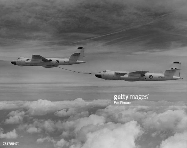 A flight of Vickers Valiant jet bombers of 214 Squadron Royal Air Force practice in flight refuelling over the Sahara whilst on their 6060 mile non...