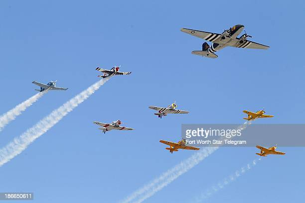 A flight of vintage war birds performs the flyover for the opening ceremonies of the O'Reilly 300 at Texas Motor Speedway in Fort Worth Texas on...