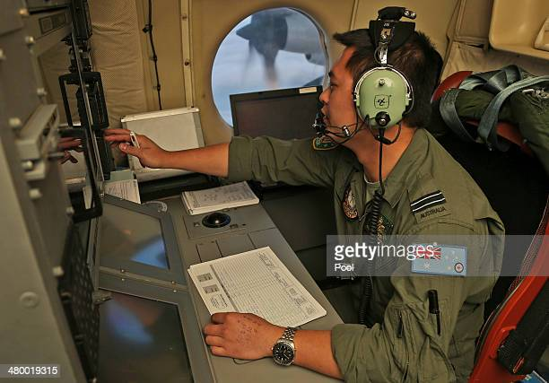 Flight Officer Jack Chen mans the navigation and comms station on board a Royal Australian Air Force AP-3C Orion as they search for debris or...