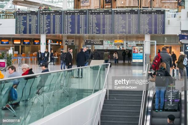 Flight passengers at the checkin area of Franz Josef Strauss Airport Munich on March 1 2018 in Munich Germany