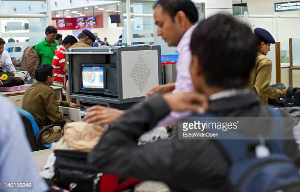 Flight passengers at the security xray control at the Aiport on February 1 2012 in Bhopal Madhya Pradesh India