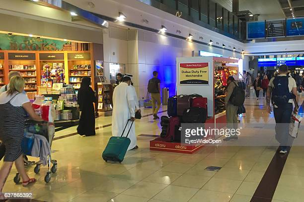 Flight passengers in the Duty Free Shopping area et Dubai International Airport on December 17 2016 in Dubai United Arab Emirates