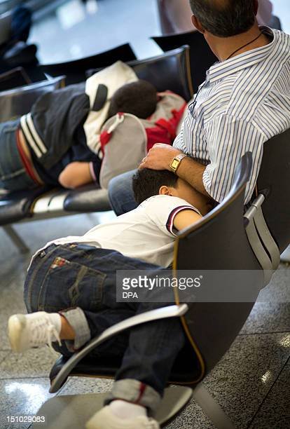 Flight passengers wait at the airport in Frankfurt/M., western Germany, where cabin staff of German airline Lufthansa staged a strike on August 31,...