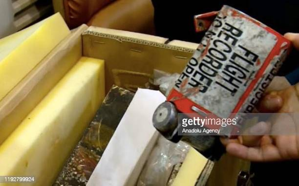 Flight recorder of the crashed Ukranian plane is displayed during a press conference of Head of Irans of Civil Aviation Organization Ali Abedzadeh in...