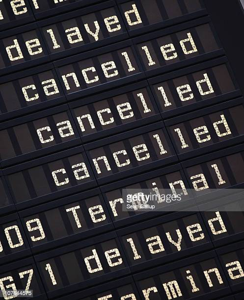 A flight schedule board shows cancelled and delayed flights at Munich Airport on December 17 2010 in Munich Germany 'Petra' a lowpressure front...