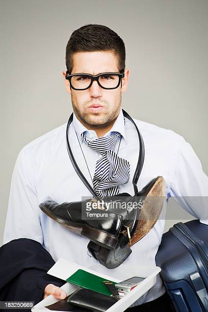 flight security hassle _ stressed business passanger - security check stock photos and pictures