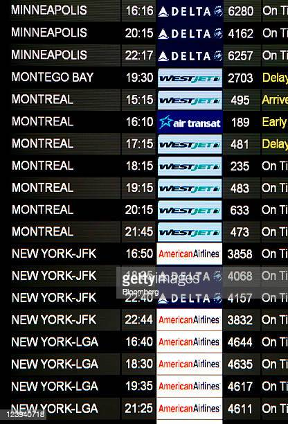 Flight times appear on a board in the arrivals hall at Toronto Pearson International Airport in Toronto Ontario Canada on Tuesday Aug 30 2011 Toronto...