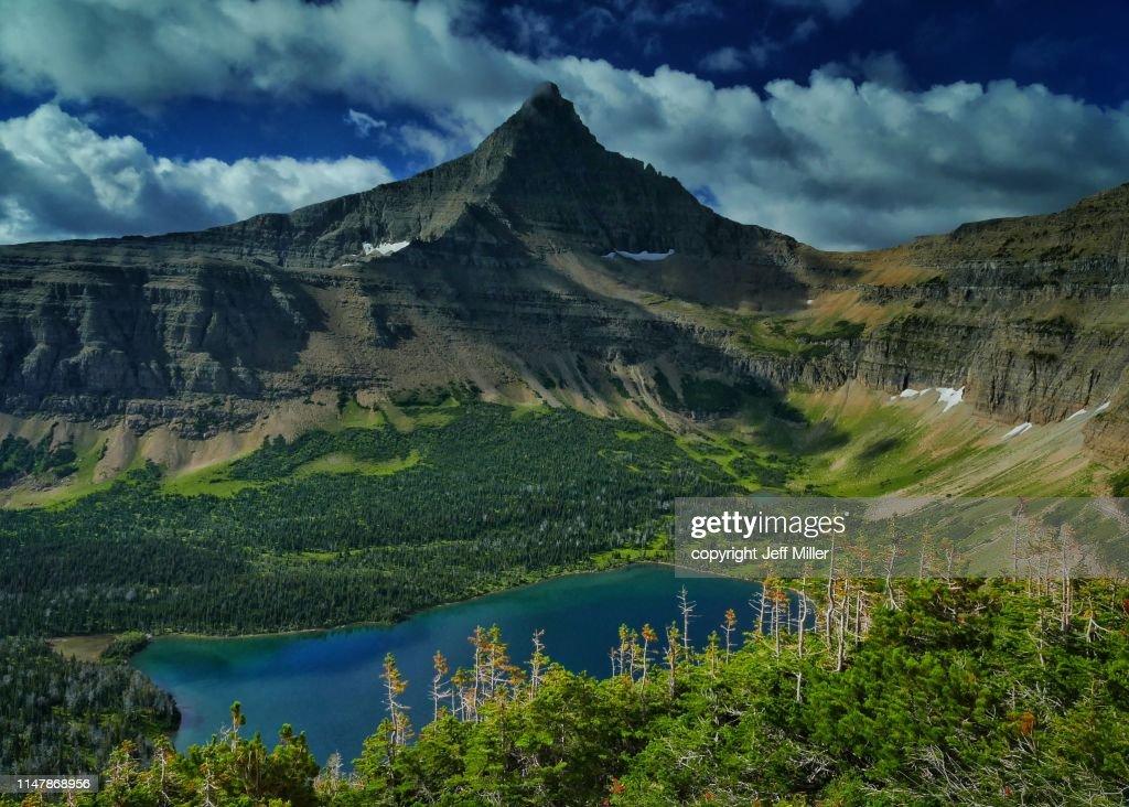 Flinsch Peak rises above Oldman Lake, Two Medicine District, Glacier National Park, Montana, USA. : Stock Photo