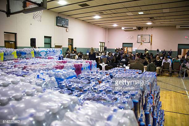 Flint CFO Jody Lundquist addresses residents' concerns regarding water bills at a town hall meeting held by Flint Mayor Karen Weaver about water...