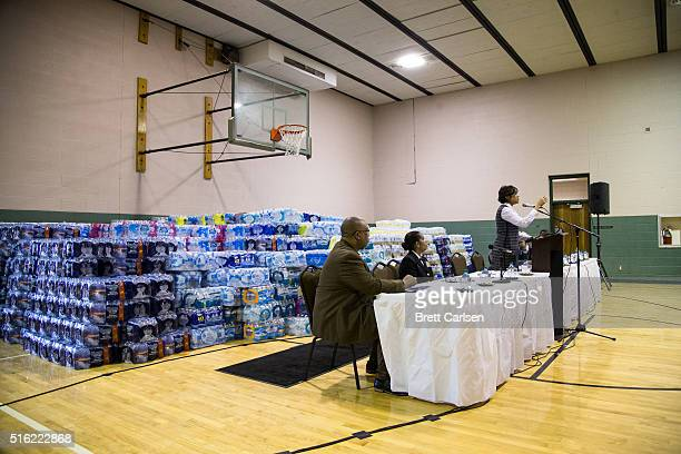 Flint Mayor Karen Weaver speaks to residents during a town hall on water public safety and job opportunities on March 17 2016 in Flint Michigan Flint...