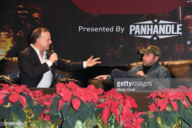 Flint Rasmussen and actor Rory Cochrane speak onstage during the Outside the Barrel with Flint Rasmussen show during the National Finals Rodeo's...