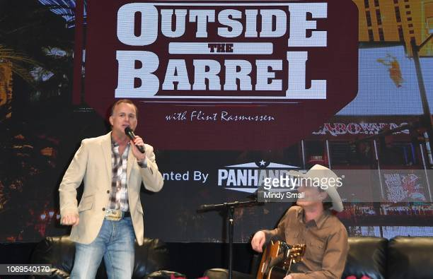 Flint Rasmussen and Ned LeDoux speak onstage during the Outside the Barrel with Flint Rasmussen show during the National Finals Rodeo's Cowboy...