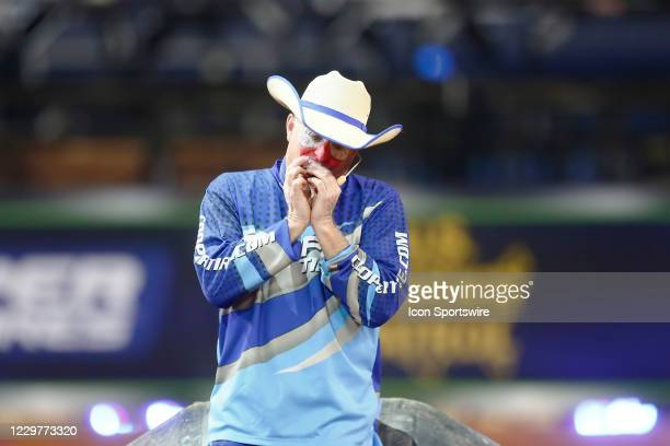 Flint Rasmussen plays a harmonica during the PBR World Finals, on November 15th at the AT&T Stadium, Arlington, TX.